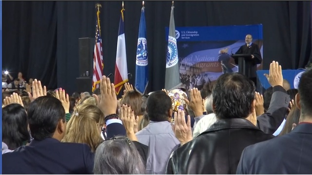 Hundreds of immigrants sworn in as U.S. citizens